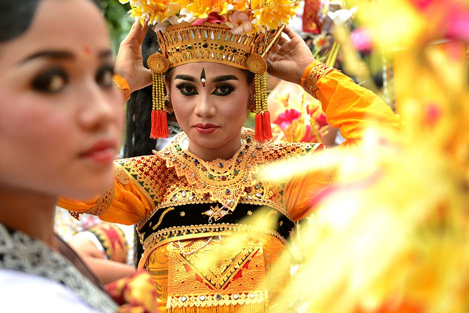 A Balinese girl during in a cultural parade at a festival to mark the New Year in Bali, Indonesia.