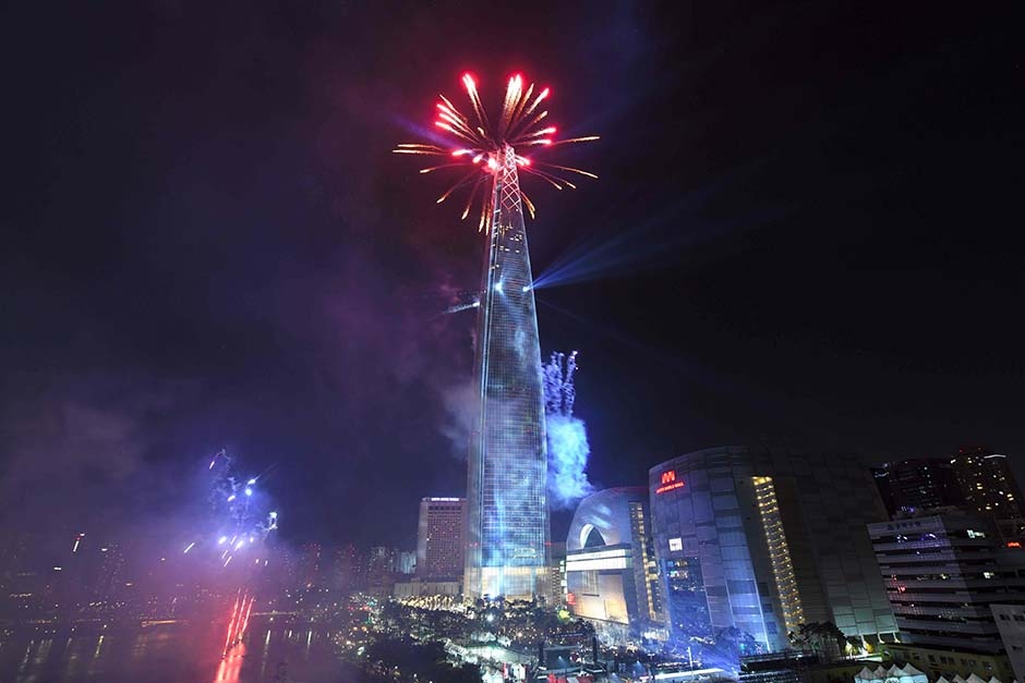 Fireworks light the sky over the Lotte World Tower in Seoul, South Korea on January 1, 2018