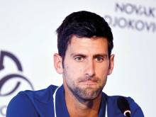 Djokovic back with a bang at Kooyong