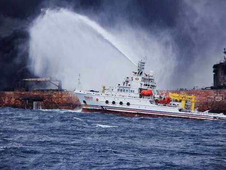 "the Chinese firefighting vessel ""Donghaijiu 117"" spraying foam on the burning oil tanker ""Shanchi"