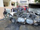 Lebanese soldiers are seen inspecting a damaged car in Sidon, Lebanon.