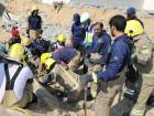 Six workers rescued after wall collapses on them