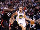 Golden State Warriors guard Klay Thompson (11) drives against Toronto Raptors forward Pascal Siakam during the second half of an NBA basketball game in Toronto.