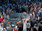 Attendees take photographs of a 2019 Ford Mustang Bullitt on display at an event during the 2018 North American International Auto Show in Detroit, Michigan, on Sunday.