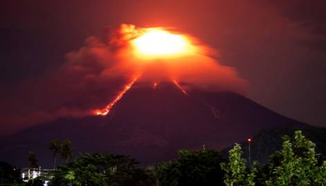 Red lava rolls down from Philippine volcano