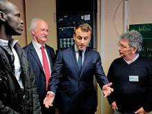 Macron visits migrants in Calais
