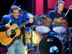 FILE PHOTO: Singer/guitarist Glenn Frey of the Eagles, with singer/drummer Don Henley in the background, performs in Las Vegas, Nevada, U.S., August 9, 2003.  REUTERS/Ethan Miller/File Photo