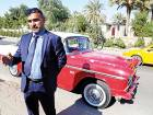 Nashwan Shakir Mahmoud with his 1955 Chevrolet coupe in Baghdad. The car survived three years of war and upheaval. Mahmoud also owns a 1964 GMC pickup.