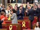 'Esquerra Republicana de Catalunya' - ERC (Republican Left of Catalonia) member of parliament Roger Torrent (centre) is congratulated after being elected new parliament speaker of the Catalan parliament in Barcelona.