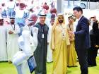 Shaikh Mohammad Bin Rashid looks at a robot during a tour of the various pavilions at the Abu Dhabi Sustainability Week 2018 yesterday. Shaikh Mansour and Shaikh Hazza are present.