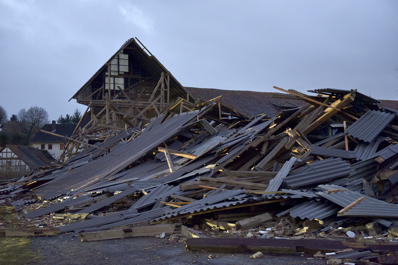 An agricultural building that collapsed during a heavy storm in Meimbressen, central Germany, Thursd