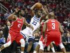 Timberwolves forward Andrew Wiggins (centre) tries to spark a move during the third quarter against the Rockets.