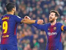 Messi and Suarez extend Barcelona's lead