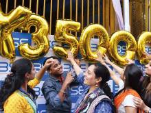 Indian stock markets hit record levels