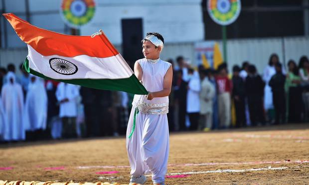 A boy carries Indian flag during the celebration of Republic day in Dubai