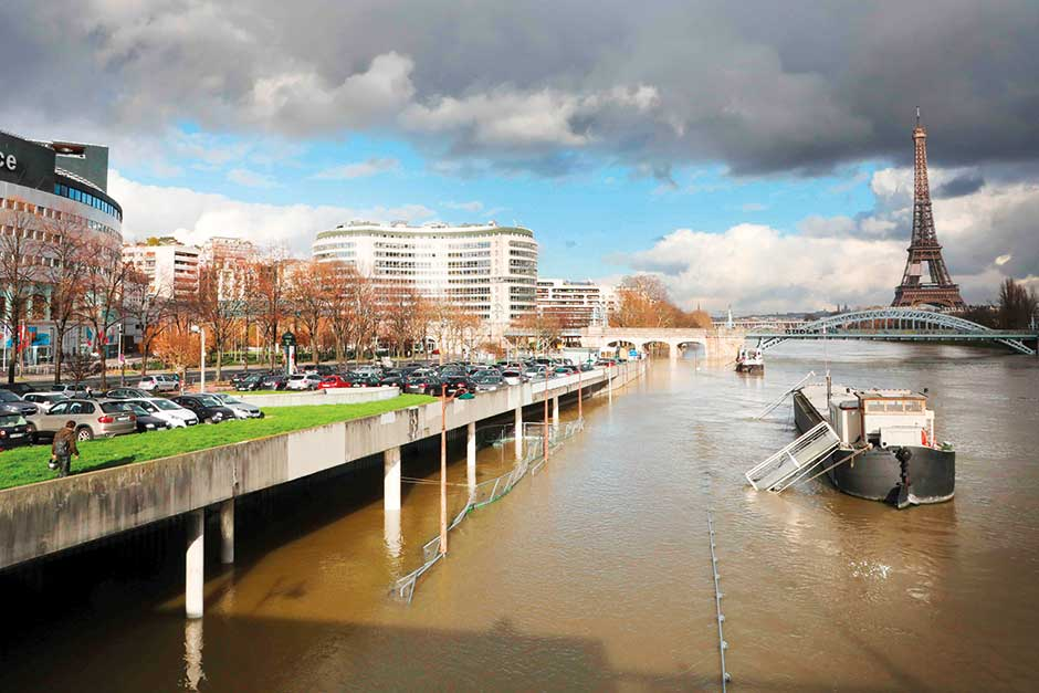 The flooded banks of the river Seine with the Eiffel Tower in the backround in Paris.