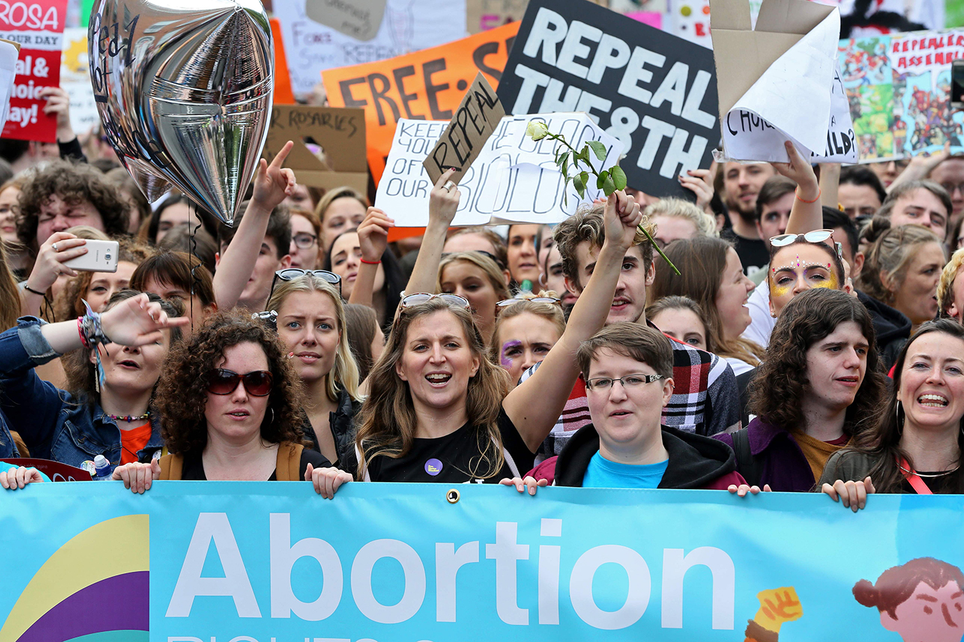 Protesters hold up placards as they take part in the March for Choice, calling for the legalising of