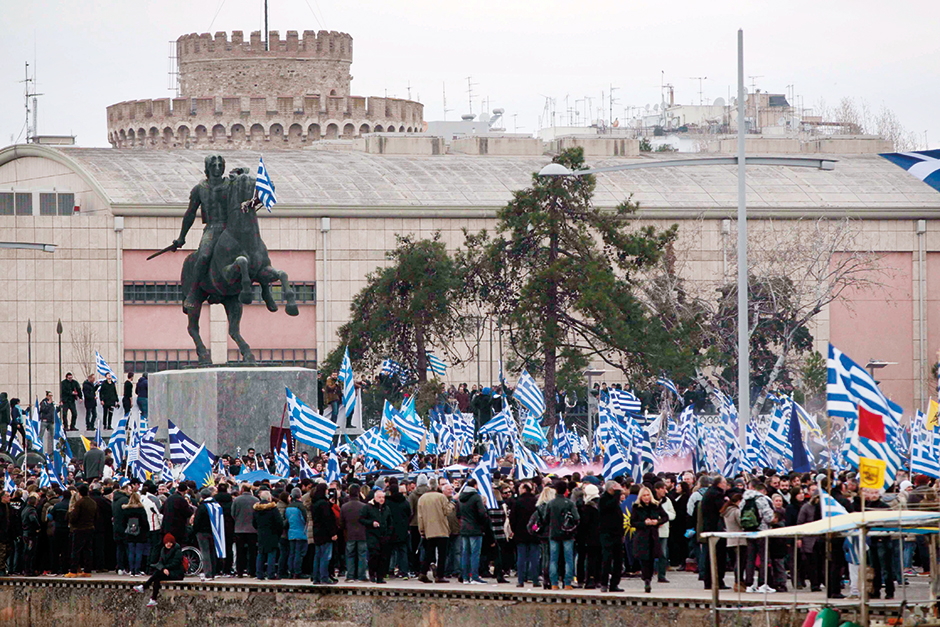 Protesters wave Greek national flags