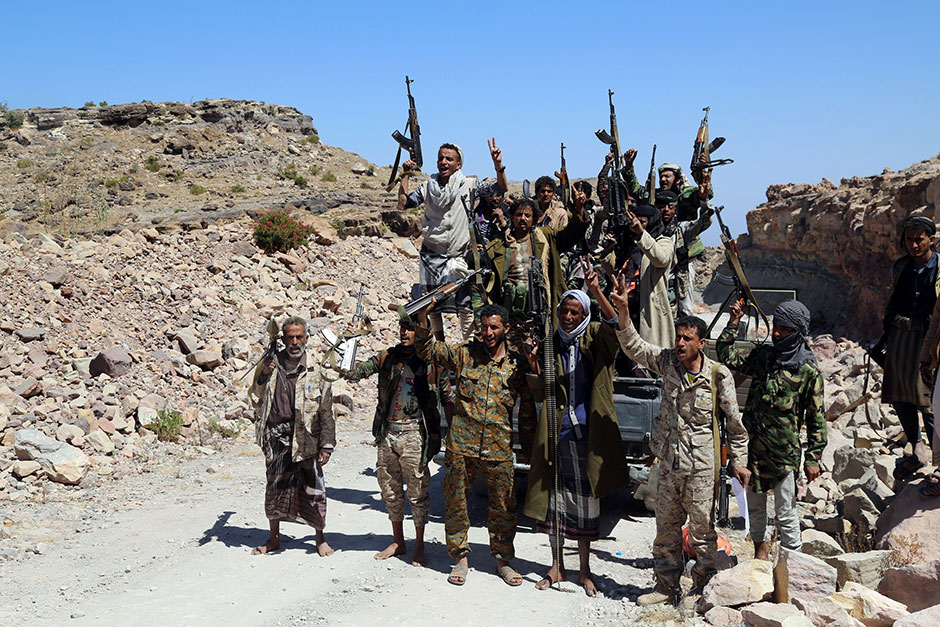 Pro-government fighters react as they made advances on Houthi fighters in Al Selw district of Taiz