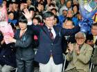 Mayor Susumu Inamine (centre) flanked by his wife, Ritsuko, celebrates his re-election in Nago, Okinawa on Jan. 19, 2014.