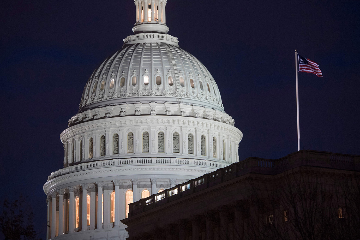 The US Capitol Building is seen at dusk in Washington, DC, February 6, 2018, as lawmakers work to av