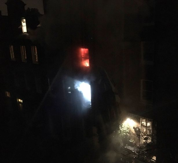 The fire began in a first-floor flat and spread to the second floor
