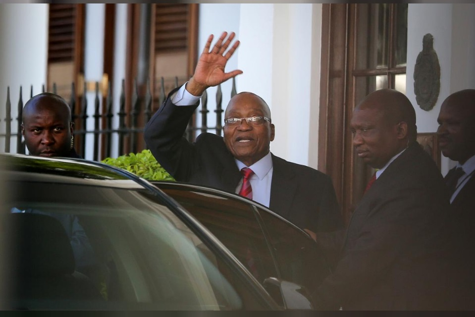 President Jacob Zuma leaves Tuynhuys, the office of the Presidency at parliament after the announcem