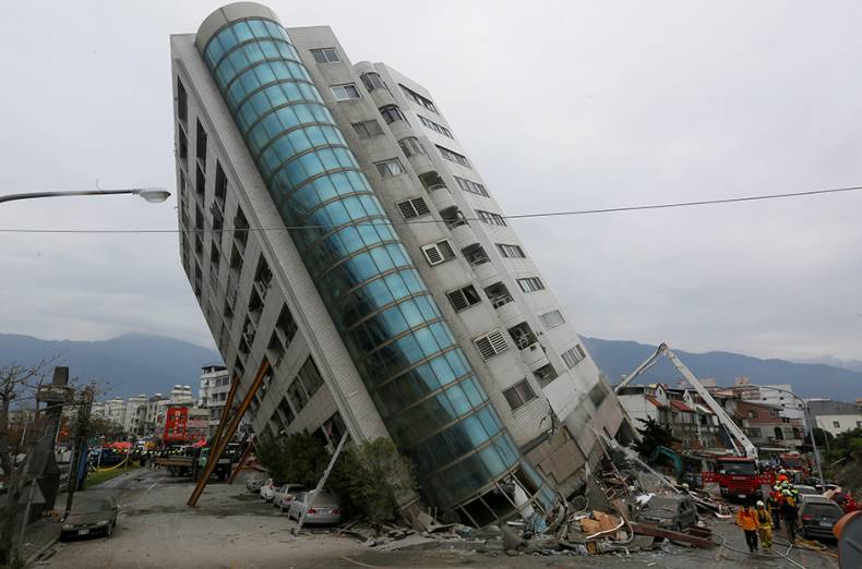 rescue-workers-are-seen-by-a-damaged-building-after-an-earthquake-hit-hualien
