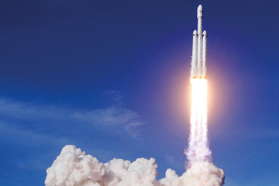 A Falcon 9 SpaceX heavy rocket lifts off