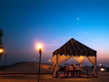 The private tent offers views of the golden desert of Dubai