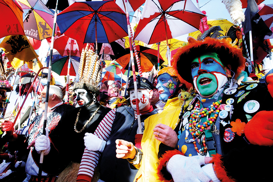 People wear local carnival costumes