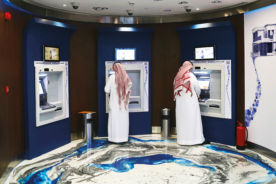 Customers use ATMs