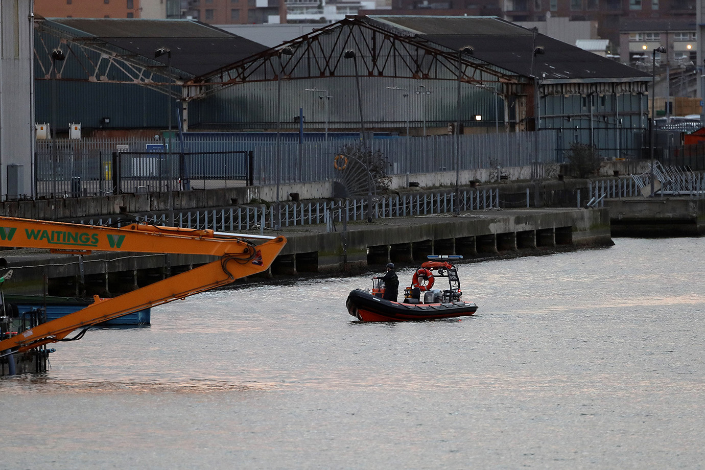 A bomb disposal team stand on a boat on near London City Airport, in London, Britain February 12, 20