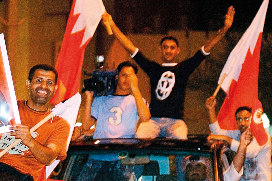 Bahrainis celebrate in Manama on October 25, 2002 after parliamentary elections