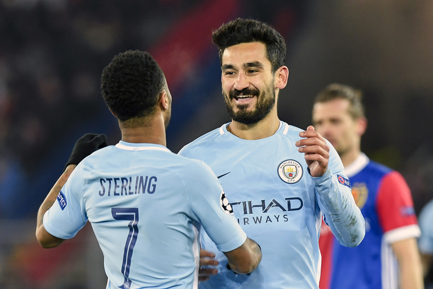 Manchester City's Ilkay Gundogan, right, celebrates his second goal with Raheem Sterling.