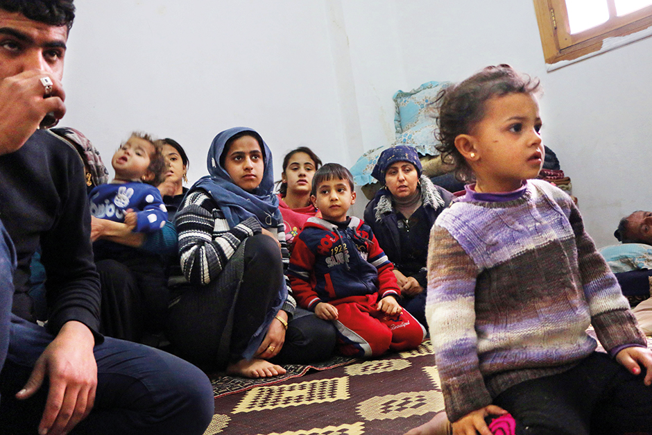 Members of seven displaced Syrian families