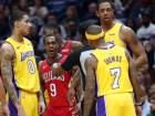New Orleans Pelicans guard Rajon Rondo (9) and Los Angeles Lakers guard Isaiah Thomas (7) are separated by an official during the first half of an NBA game.