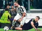 Juventus' forward from Argentina Gonzalo Higuain (left) fights for the ball with Tottenham's defender Jan Vertonghen during the Champions League Round of 16 first leg.