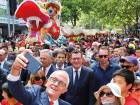 Australian Prime Minister Malcolm Turnbull takes a selfie as he walks with Victorian Premier Daniel Andrews and members of the public during a parade as part of the Chinese New Year Festival in Melbourne, Australia on Sunday