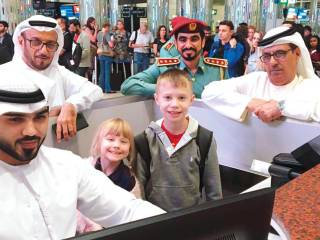 2 kids stamped their passports in Dubai