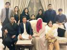 Imran Khan sits with his spiritual guide and third wife Bushra Maneka in Lahore on Sunday evening.