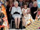 Britain's Queen Elizabeth II sits next to Vogue Editor-in-Chief Anna Wintour and Caroline Rush, Chief Executive of the British Fashion Council, and royal dressmaker Angela Kelly at London Fashion Week.