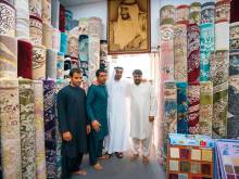 Mohammad Bin Zayed visits Afghani carpet-seller