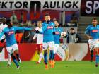 Napoli's Piotr Zielinski celebrates scoring their first goal with teammates during the Europa League Round of 32 second leg match against Leipzig at the Red Bull Arena.