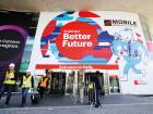 Workers leave the Mobile World Congress in Barcelona, Spain. Some brands such as Huawei, LG, Oppo and HTC have opted out to have individual events for flagship launches.