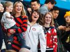 Ivanka Trump, daughter of US President Donald Trump (left) holds a child beside United States curler Becca Hamilton (centre) as they watch the men's final curling match between the US and Sweden in Gangneung on Saturday.