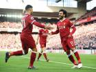 Liverpool midfielder Mohammad Salah (right) celebrates with Alex Oxlade-Chamberlain after scoring the team's second goal against West Ham United at Anfield.