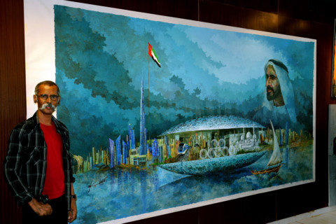 NAT_180304 Akbar Saheb with his latest masterpiece, 'Zayed's Seven Pearls'