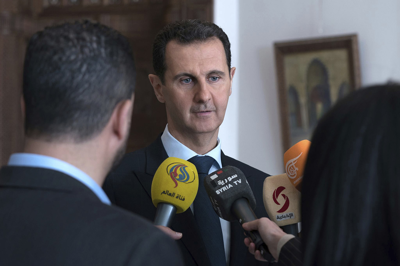 Syrian President Bashar Al Assad speaks with reporters, in Damascus, Syria, Sunday, March 4, 2018.
