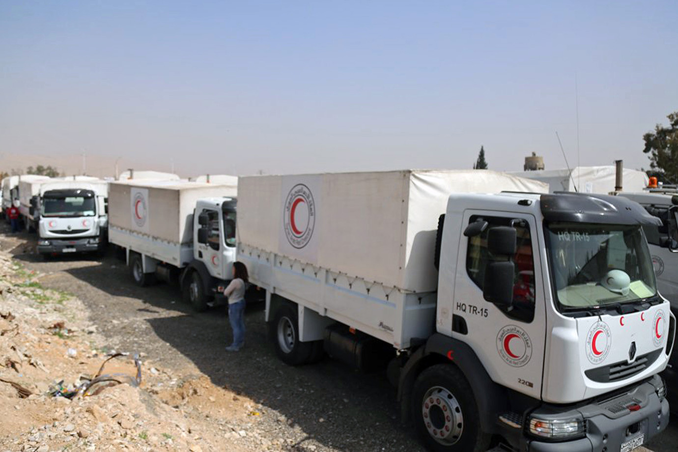 A convoy of vehicles of the Syrian Red Crescent arrive in Douma, Eastern Ghouta, a suburb of Damascu